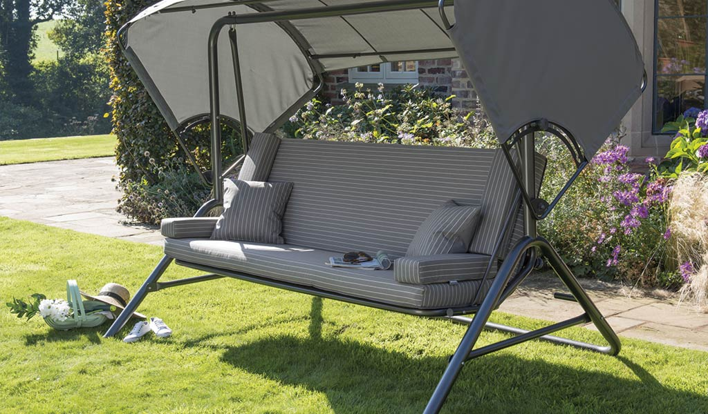 Novero Swing / Daybed from KETTLER's Classic garden Furnitrue range on a lawn in a garden