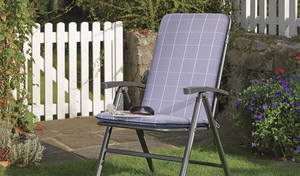 Novero Multi Position Recliner from KETTLER's Classic garden Furniture range on a lawn.