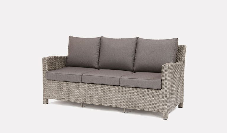 Palma 3 Seater Sofa in white wash from KETTLER's Casual Dining Garden furniture range on a grey background.