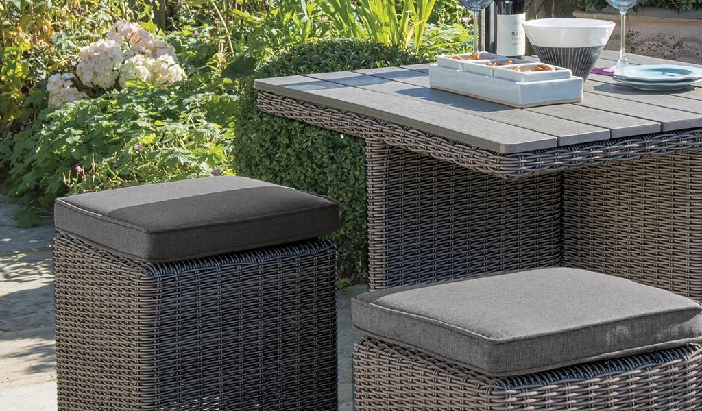 Detail of the Palma Cube 4 Seater Set in rattan wicker from KETTLER's Casual Dining range on a patio