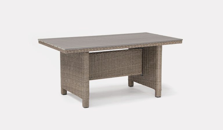 Palma Dark Oak Slat Top table in rattan from KETTLER's Casual Dining Garden furniture range on a grey background.