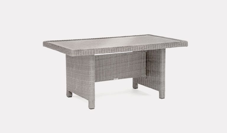 Palma Glass Top table in white wash from KETTLER's Casual Dining Garden furniture range on a grey background.