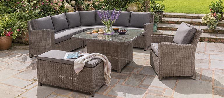 Palma Grande Corner Set with Armchair and Bench in rattan from KETTLER's Casual Dining range on a patio