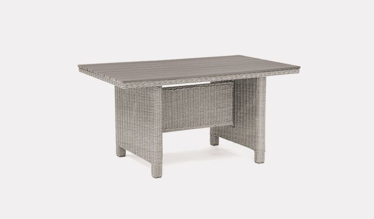 Palma Mini Dark Oak Slat Top table in white wash from KETTLER's Casual Dining Garden furniture range on a grey background.