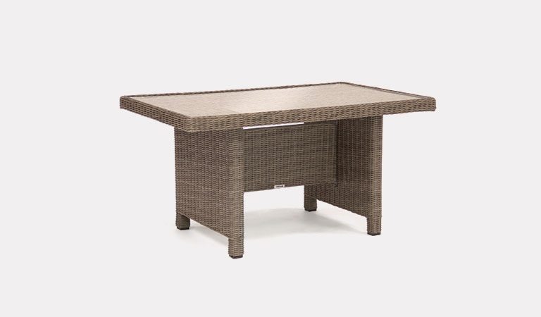 Palma Mini Glass Top table in rattan from KETTLER's Casual Dining Garden furniture range on a grey background.