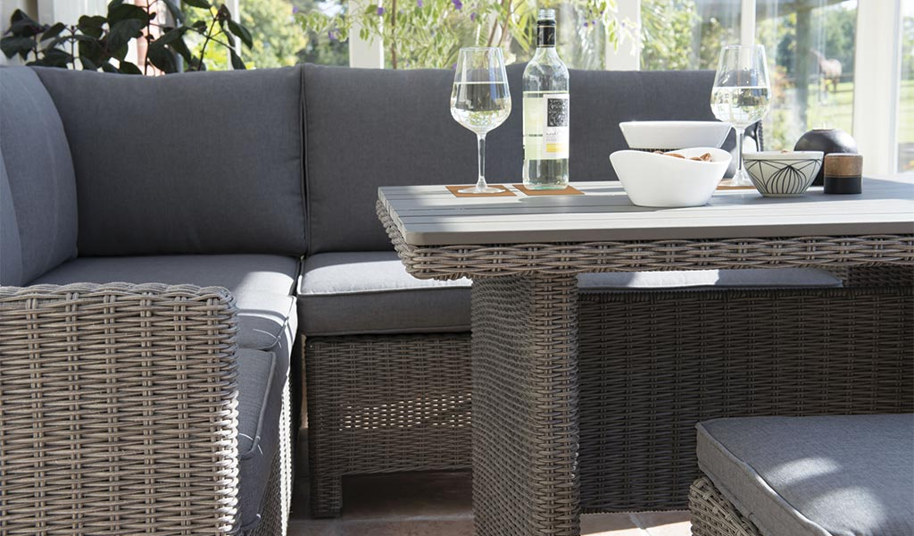 Slat top table detail of the Palma Mini Set in rattan from KETTLER's Casual Dining range in a conservatory