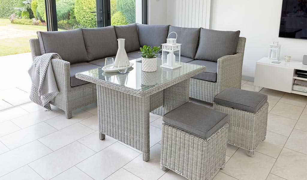 Palma Mini Set in white wash with glass top table from KETTLER's Casual Dining range in a conservatory