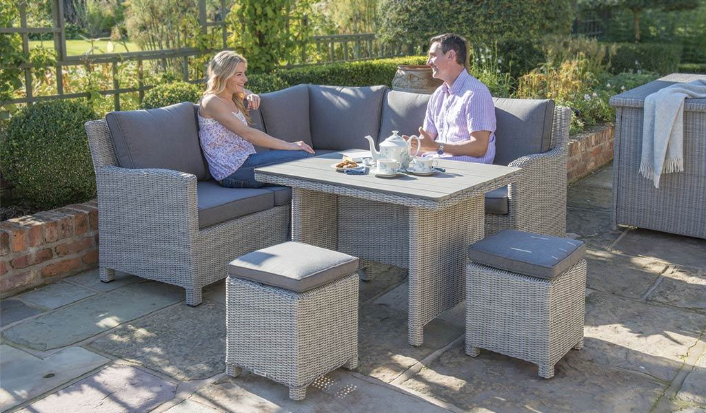 Palma Mini Set in white wash with slat top table from KETTLER's Casual Dining range on a patio.