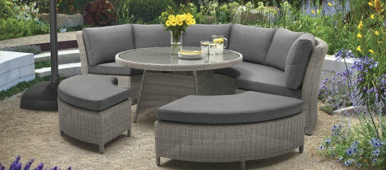 The Palma Round Set in White Wash on a graveled patio area.