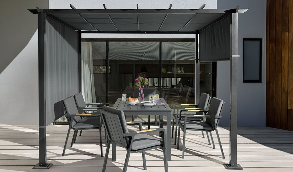 The Parsol Dining Set covered by a Panalsol on a patio.
