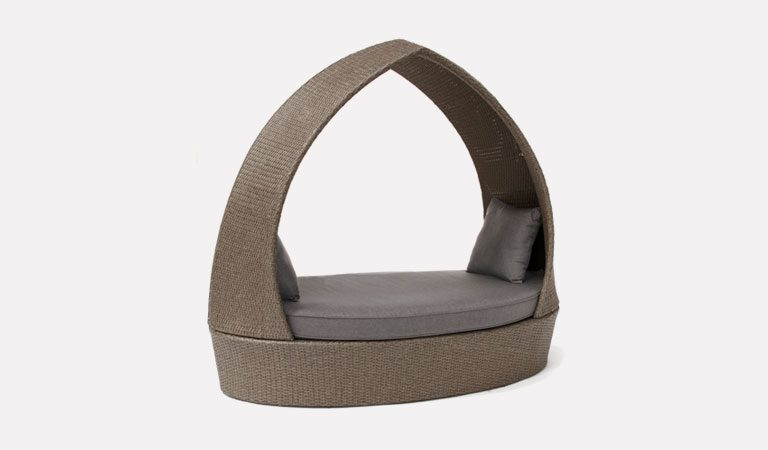 the pod in rattan from kettlers classic garden furniture range on a grey background