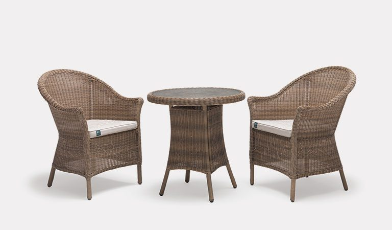 RHS Harlow Carr 2 Seater Bistro Set from the RHS by KETTLER Garden furniture range on a grey background.