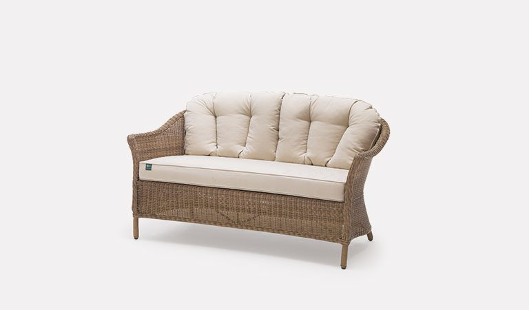RHS Harlow Carr 2 Seater Sofa with cushions from the RHS by KETTLER garden furniture range on a grey background.