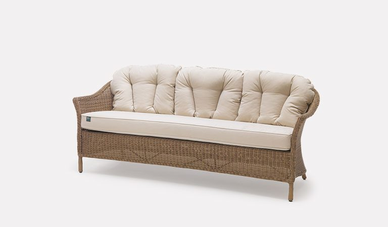 RHS Harlow Carr 3 Seater Sofa with cushions from the RHS by KETTLER garden furniture range on a grey background.