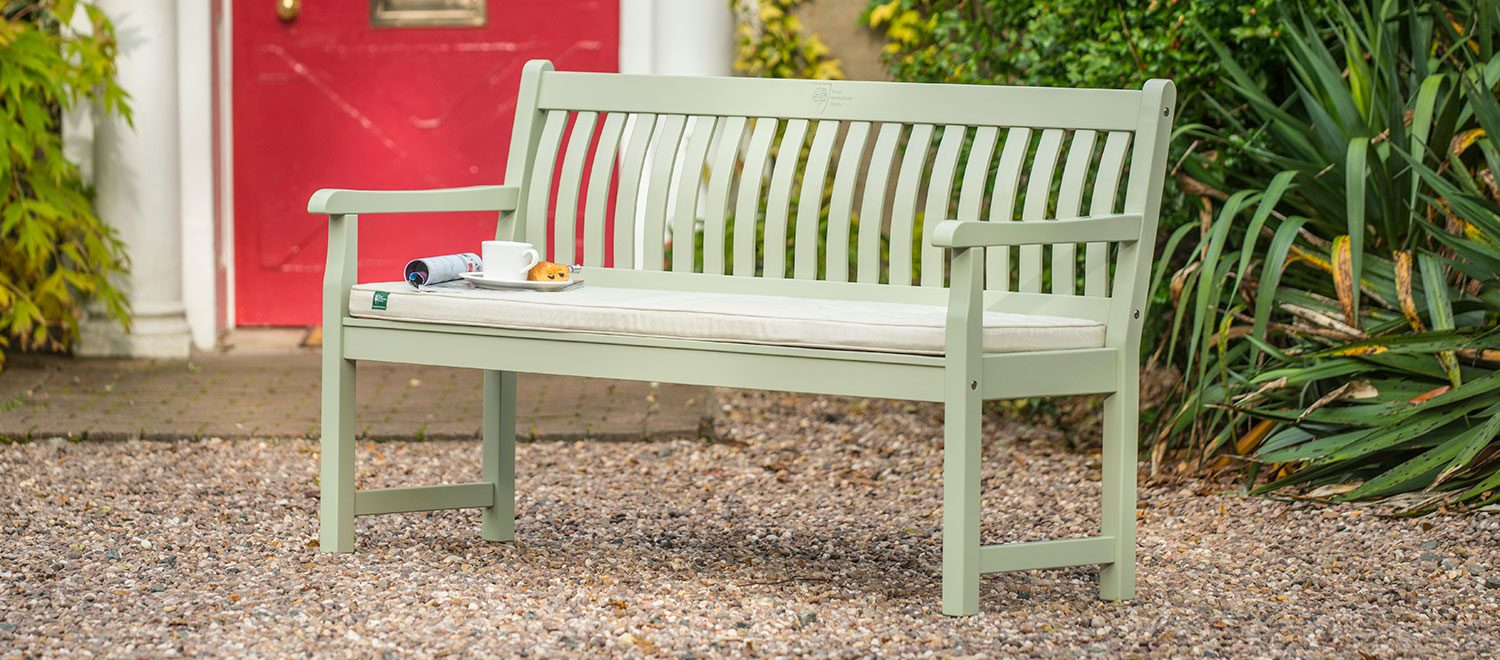 RHS Rosemoor 5ft Bench with cushions from the RHS by KETTLER garden furniture range on a stoned patio