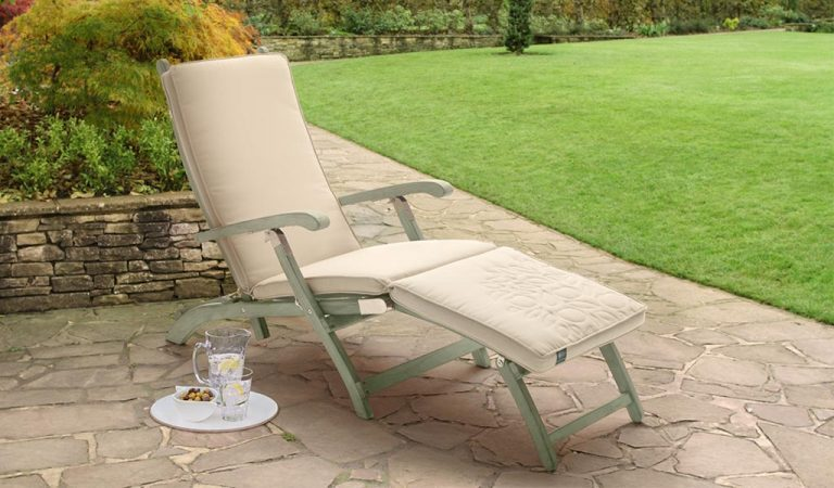 The Rosemoor Steamer with Cushion from the RHS by KETTLER garden furniture range on a patio.