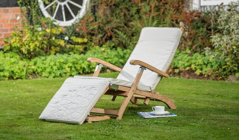 The Wisley Steamer with Cushion from the RHS by KETTLER garden furniture range on a lawn..