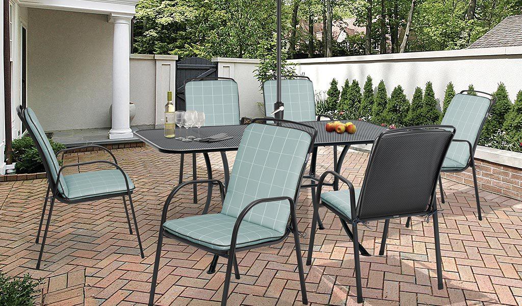 Savita 6 Seater Dining Set with Aqua Check cushions from KETTLER's Classic range on a patio