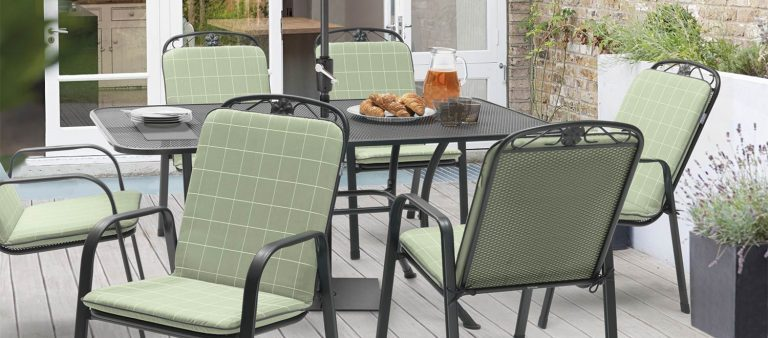 Siena 6 Seater Dining Set with Sage Check cushions from KETTLER's Classic range on a patio