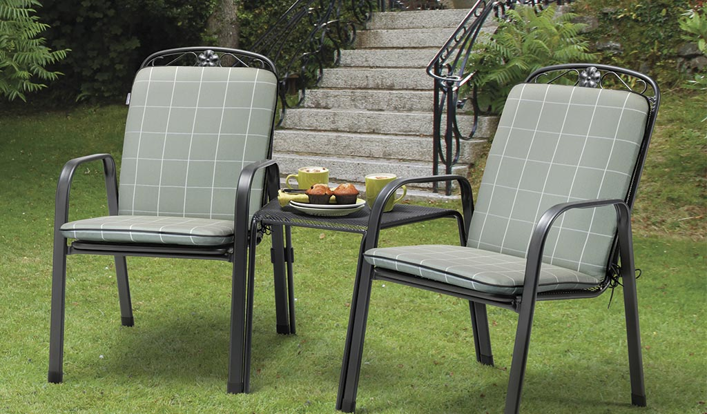 Siena Companion Set with Sage Check cushions on a lawn in the garden.