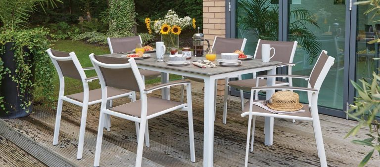 Treviso Dining Chair in Table in Taupe/Hessian from KETTLER's Classic garden furniture range on a patio.