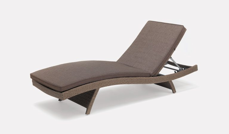 Universal Wicker Lounger in rattan from KETTLER's garden furniture range on a grey background.