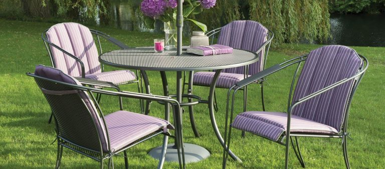 Venezia 4 Seater Dining Set with Amethyst seat pads from KETTLER's Classic range in a garden