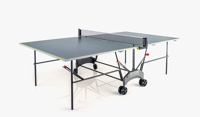 KETTLER's AXOS Indoor Table Tennis Table on a grey background.