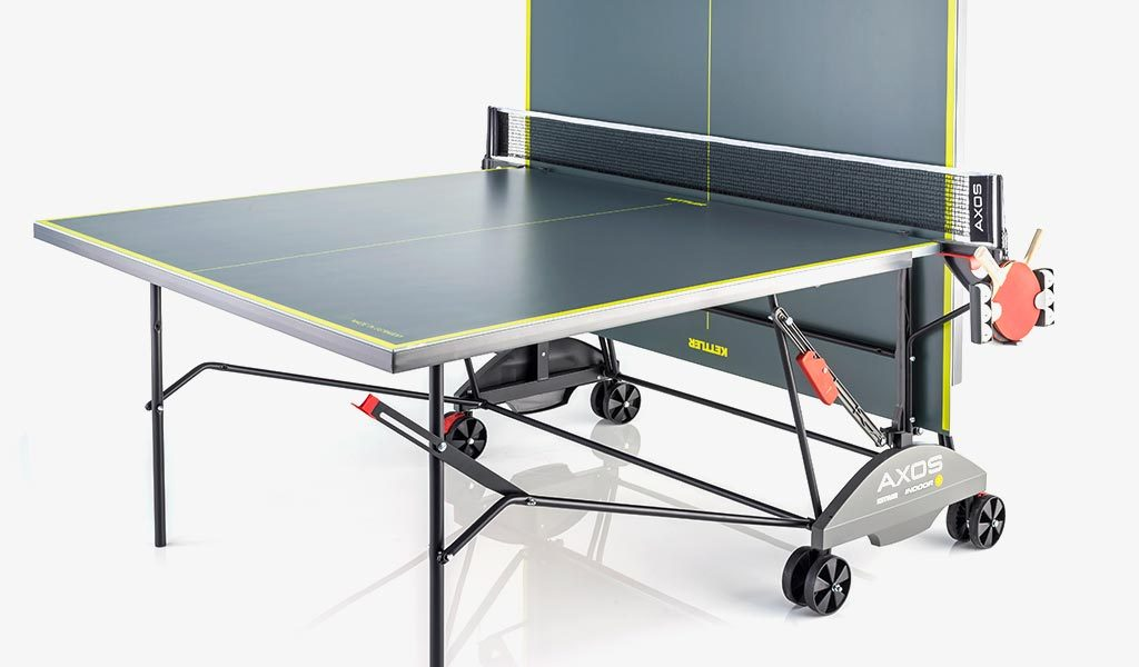 Detail of the AXOS Indoor 3 Table Tennis Table on a grey background.