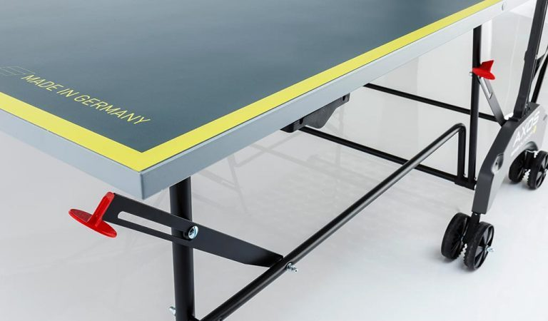 Detail of the AXOS Outdoor 1 Table Tennis Table on a grey background.