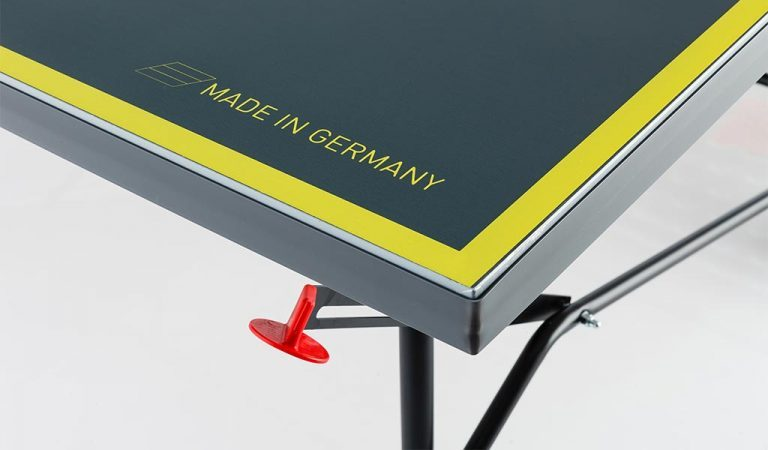 Detail of the AXOS Outdoor 3 Table Tennis Table on a grey background.