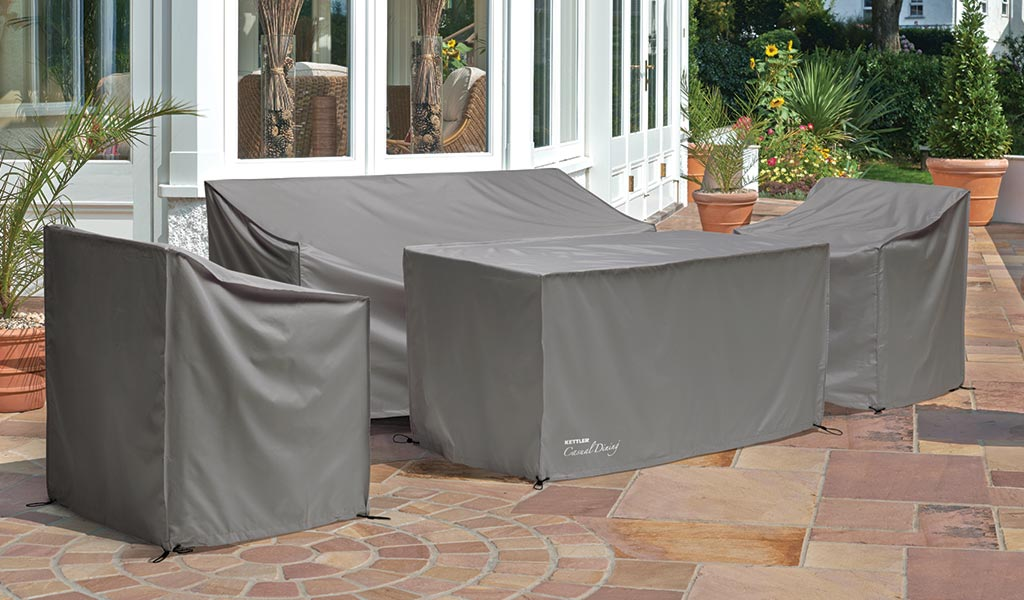 Protective Cover for the Palma Sofa Set from KETTLER's Casual Dining garden furniture range on a patio.