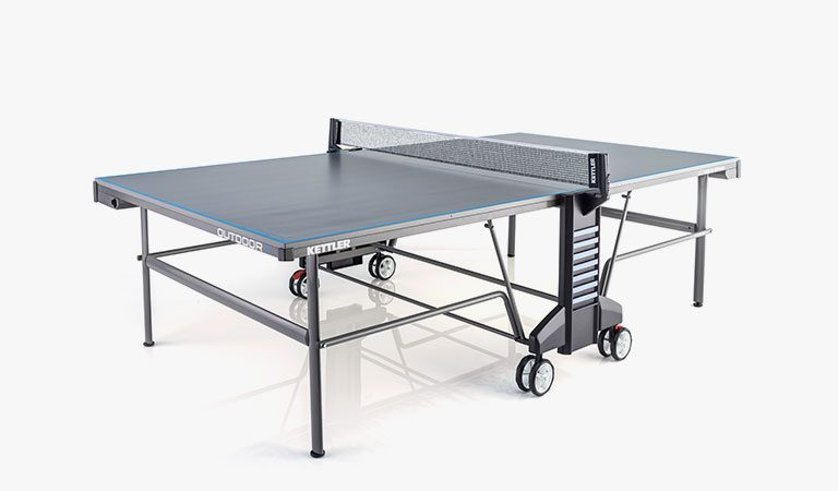 KETTLER's Classic Outdoor 6 Table Tennis Table on a grey background.