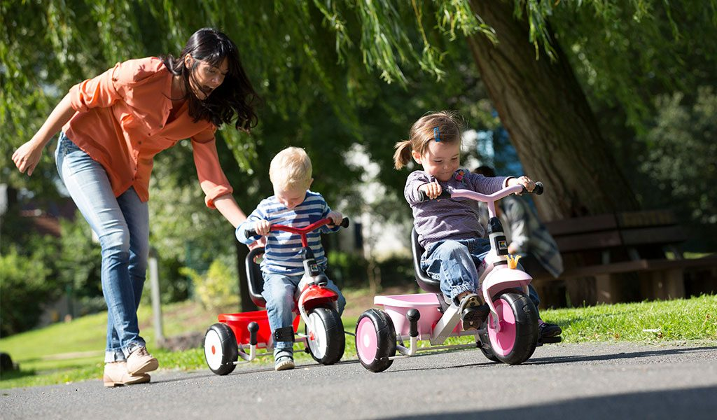 Kettler Happy Trike Racing and Princess with mother and children
