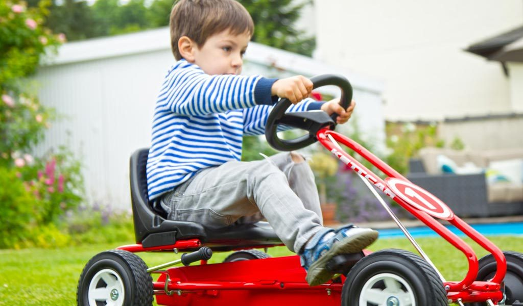 Boy racing on Kettler Spa Go Kart