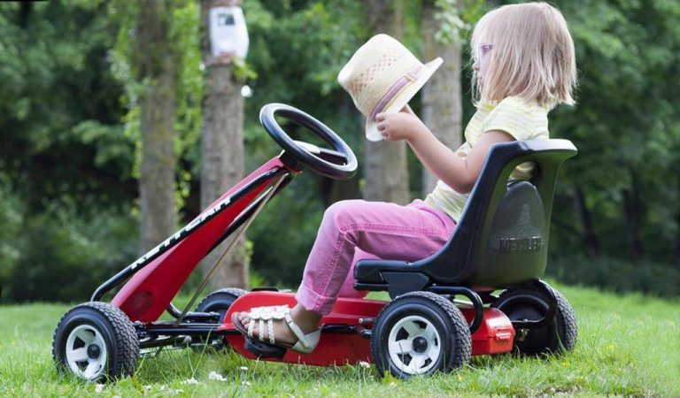 Little girl plays on Kettler Melbourne go kart