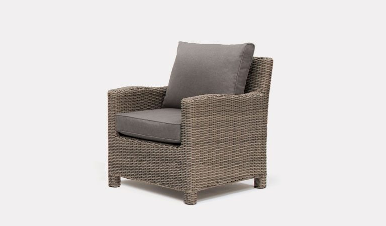 The Palma Armchair in Rattan from KETTLER's Casual Dining Garden furniture range on a grey background.