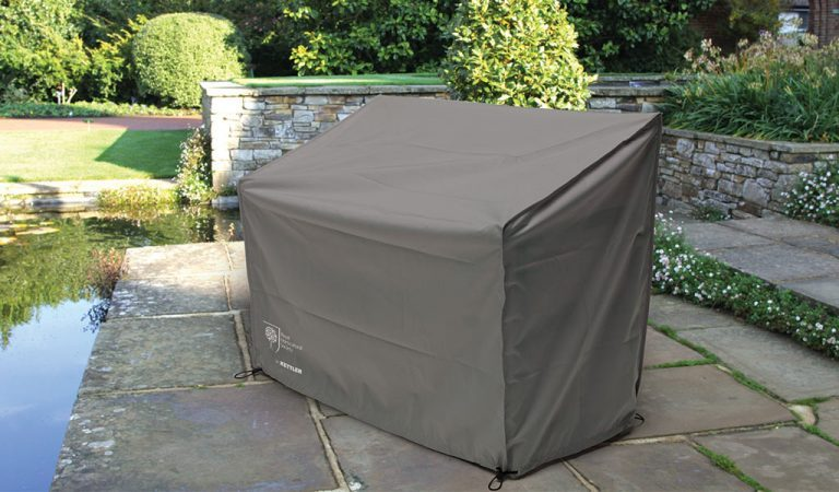 Protective Cover for the 4ft Bench from RHS by KETTLER garden furniture range on a patio.