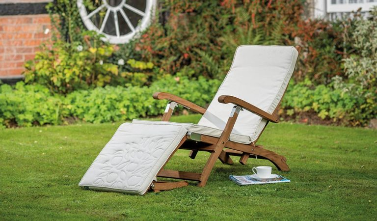 The Chelsea Steamer with Cushion from the RHS by KETTLER garden furniture range on a lawn..