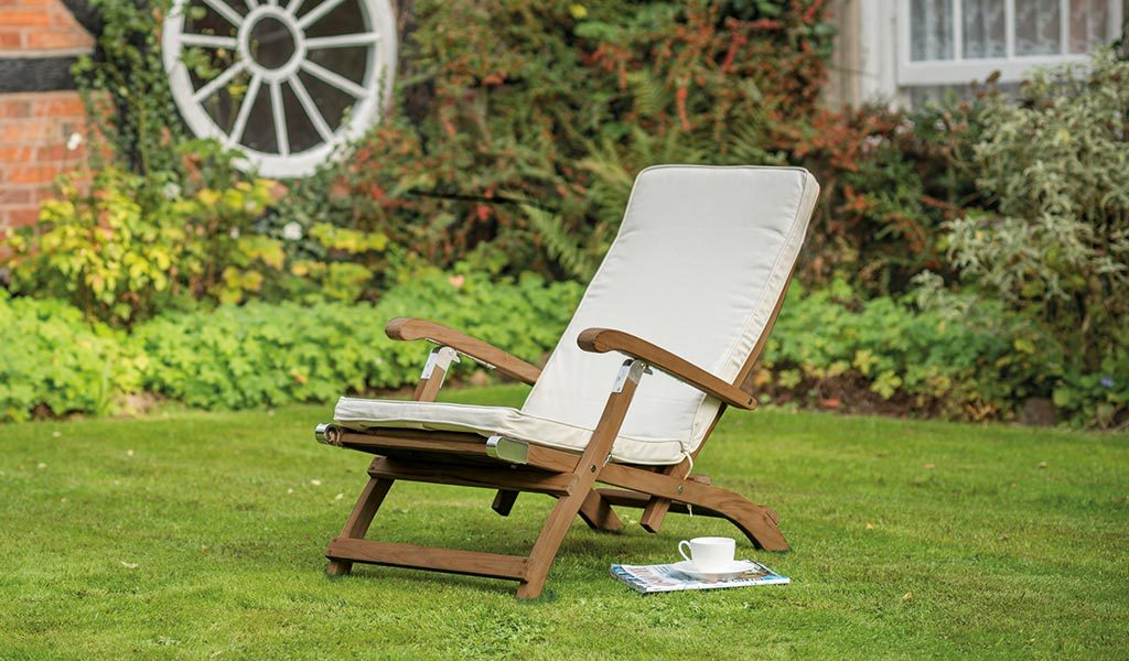 The Chelsea Steamer with Cushion from the RHS by KETTLER garden furniture range on a lawn.