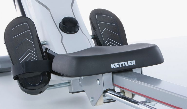 Detail of the Coach M Rowing Machine from KETTLER's fitness range on a grey background.
