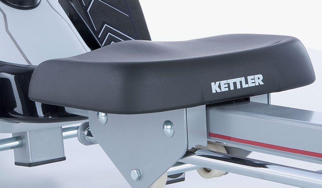 Saddle detail of the Coach M Rowing Machine from KETTLER's fitness range on a grey background.