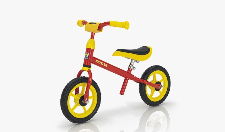 "The Speedy 10"" Balance Bike from KETTLER's Toy range on a grey background."