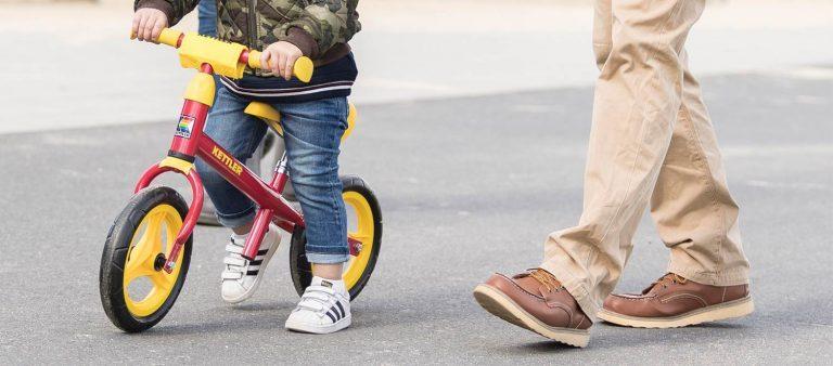 "Couple enjoying time with their boy on a KETTLER Speedy 10"" Balance Bike."
