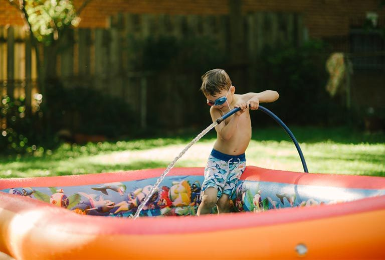 Young by playing in a rubber pool.