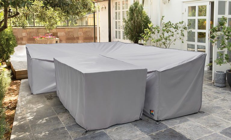 Kettler protective covers on garden furniture corner set on patio - Garden Furniture Buying Guide - Indoors Outdoors
