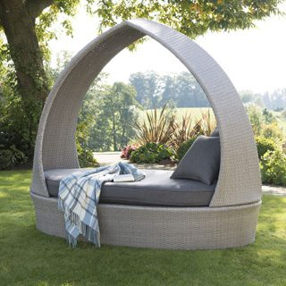 Kettler whitewash rattan relaxation pod on lawn