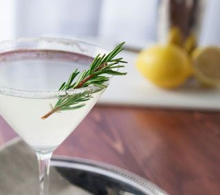 Gin martini with rosemary garnish