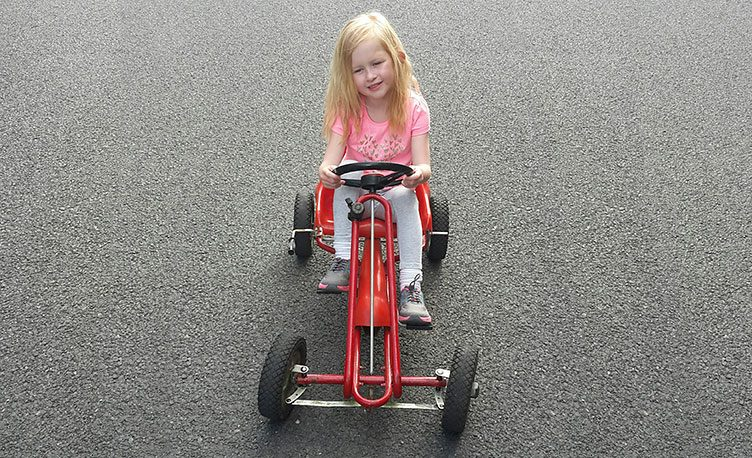 Girl playing on a 40 year old Kettler Go-Kart.