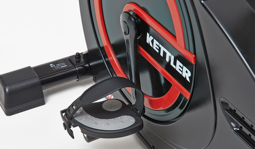 Flywheel and pedal detail of the Picos Exercise Bike from KETTLER's Fitness range.